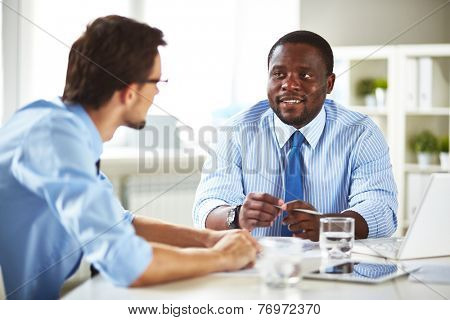 Businessman talking to a new employee
