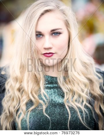 Portrait Of A Beautiful Blond Blue Eyed Teenage Girl In Green Top
