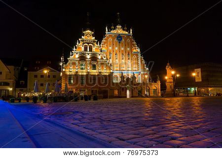 Illuminated house of the Blackheads at night in Riga, Latvia