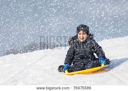 Sledding At Winter Time