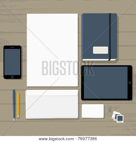 Empty stationary set on wooden background (business cards, letterhead, envelope, notepad, phone, tablet)