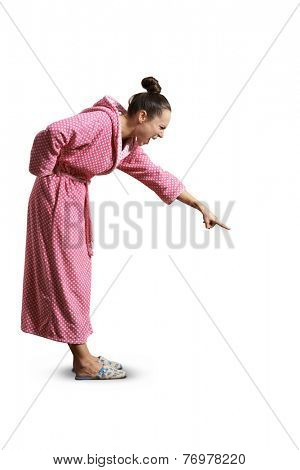 evil housewife looking down, screaming and pointing at something. isolated on white background