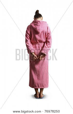 back view of guilty woman in pink dressing gown. isolated on white background