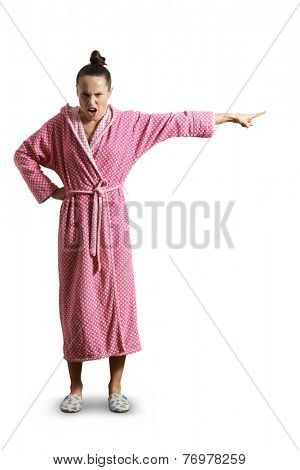 dissatisfied screaming woman in pink dressing gown looking at camera and pointing at something. isolated on white background