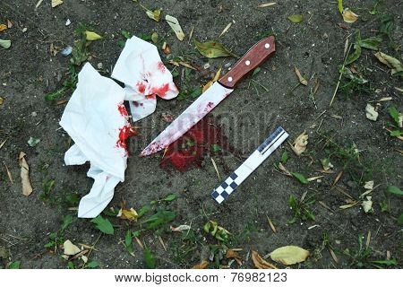 Bloody knife dragged along outdoors