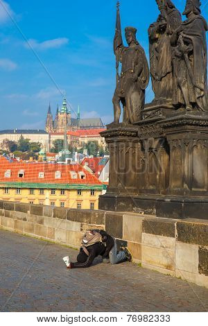 Beggar, Homeless Kneeling Begging In Prague