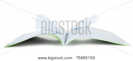Origami airplanes on notebook, on white background