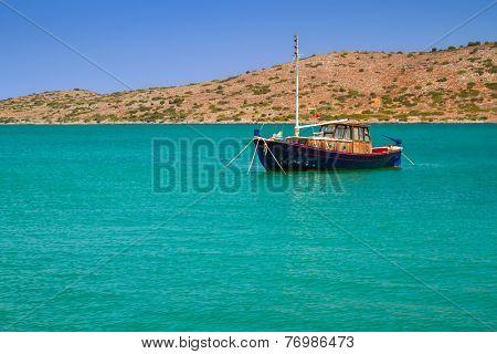 Yacht on the blue lagoon of Crete, Greece