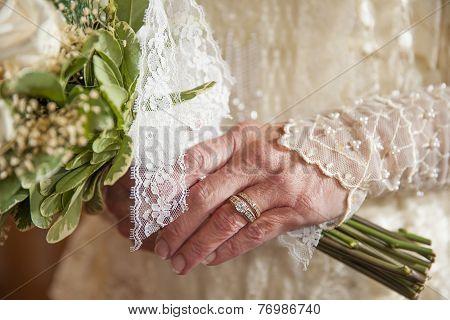Older Bride Holds Flowers