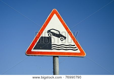 Hazard Road Signs On Sky Background