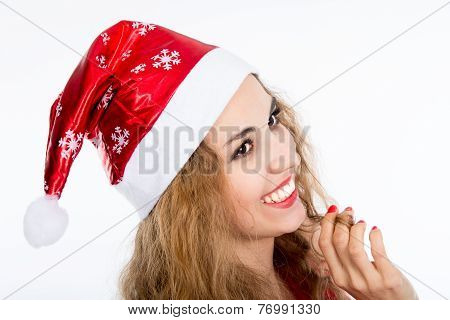 Portrait Of Joyful Pretty Woman In Red Santa Claus Hat Laughing On White Background