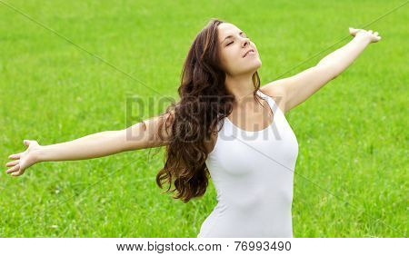 Attractive girl enjoys nature