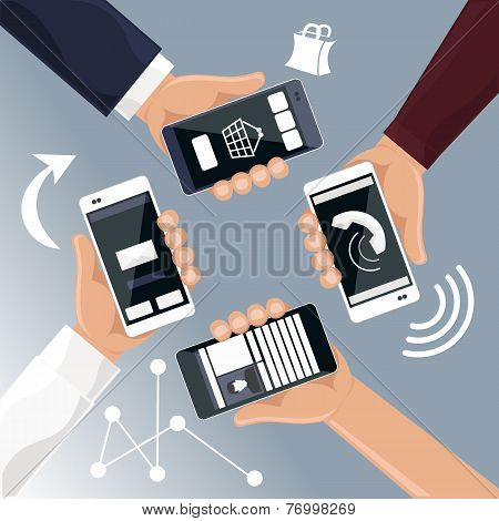 Hands holding smartphones telephones that