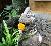 stock photo of garden sculpture  - beautiful sculpture of the deity monster with a flower in the garden - JPG