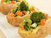 image of baked potato  - Plate with baked potatoes stuffed with vegetables - JPG