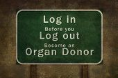 """stock photo of organ  - """"Log in before you log out become an organ donor"""" road side sign illustration, with distressed ominous background - JPG"""