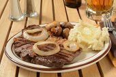 stock photo of sauteed  - Steak and mashed potatoes with butter and sauteed mushrooms  - JPG