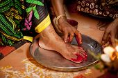 foto of pooja  - Indian bride doing marriage rituals doing colored  foot fingure their mandap puja - JPG