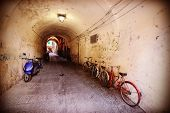 foto of neglect  - Retro filtered picture of neglected passage with bikes - JPG