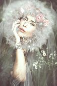 image of fable  - young beautiful  fantasy fairy woman with dandelion around her head on magic meadow - JPG