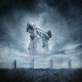 stock photo of megaliths  - Stone circle ritual with two hooded figures materialising above an ancient megalithic monument against a dark - JPG