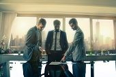 foto of mans-best-friend  - Business men meeting in the office - Three employers talking about a project ** Note: Soft Focus at 100%, best at smaller sizes - JPG