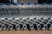 picture of local shop  - in front of a supermarket shopping carts are ready for customers - JPG