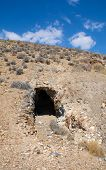 foto of gold mine  - Abandoned gold mine lies unused in the side of a desert hill in southern California - JPG