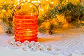 stock photo of crystal glass  - Candle in a glass candlestick, crystal, Christmas branches ** Note: Shallow depth of field - JPG