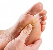 stock photo of pressure point  - Male person receiving podiatry with pressure point technique under foot isolated towards white - JPG