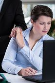 image of inappropriate  - Male boss and young attractive woman - JPG