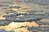 pic of freezing temperatures  - Floe flowing river - JPG