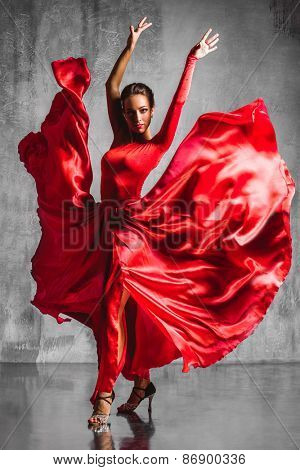 beautiful flamenco dancer posing on a studio background