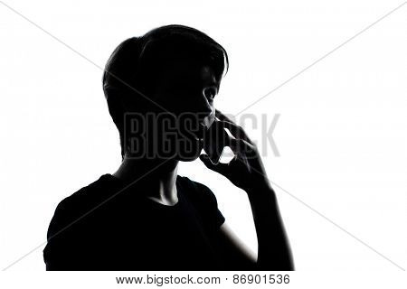 one  young teenager silhouette boy or girl on the telephone portrait in studio cut out isolated on white background