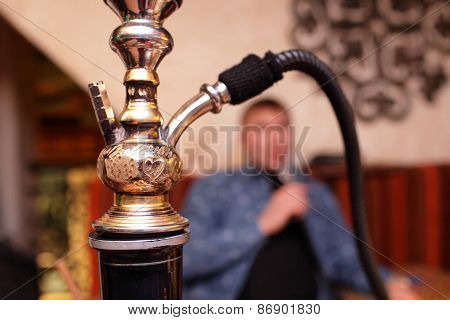 Person Smoking Shisha