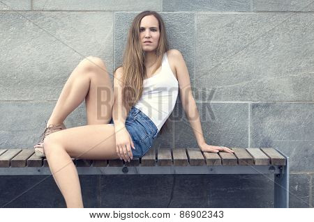 Attractive woman sitting on bench outdoor