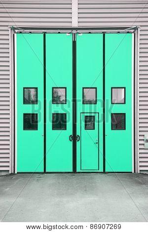 Green Garage Door on a warehouse building