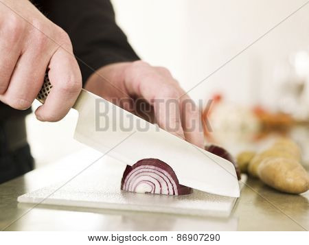 Close up of a man Cutting onion with knife