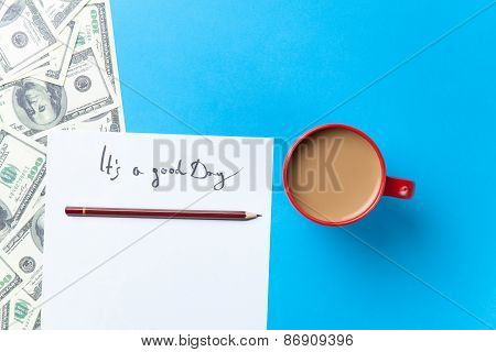Cup Of Coffee And Paper With Inscription And Dollars
