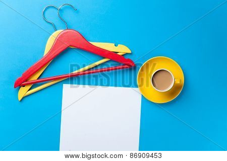 Cup Of Coffee And Paper With Hangers