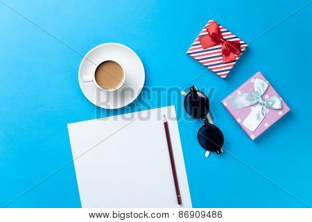 Cup Of Coffee With Sunglasses, Gift And Paper