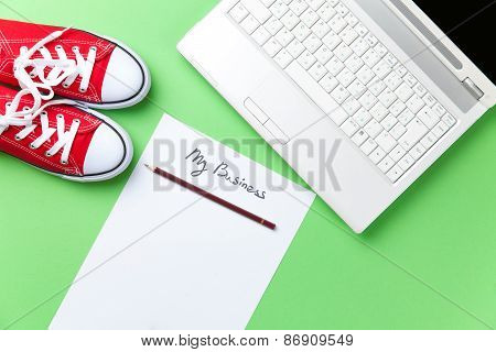 Gumshoes And Paper Near Notebook