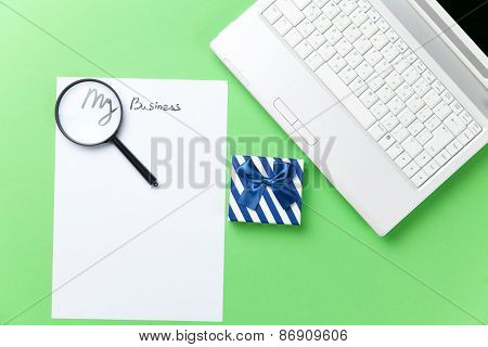 Loupe, Paper And Gift With Computer