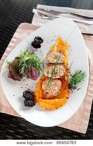 White meat patty cakes with pumpkin mash
