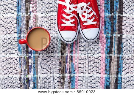Cup Of Cappuccino And Red Gumshoes