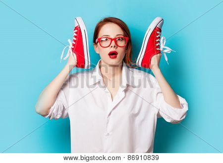 Surprised Redhead Girl In White Shirt With Gumshoes
