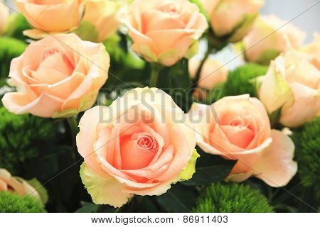 Yellow with orange roses