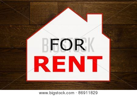 House for rent on wooden background