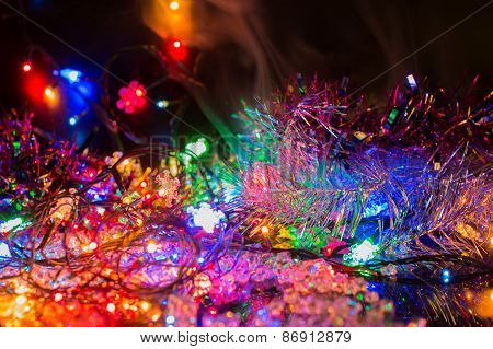 Bright Colored Garlands Bulb Shines In The Dark Background, Selective Focus