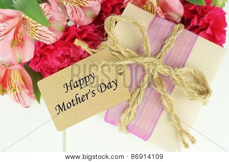Mother's Day gift with tag and flowers